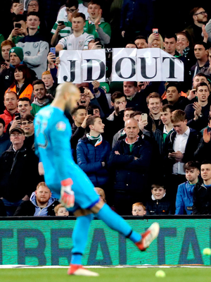 Fans protest in Georgia. Photo: Niall Carson/PA