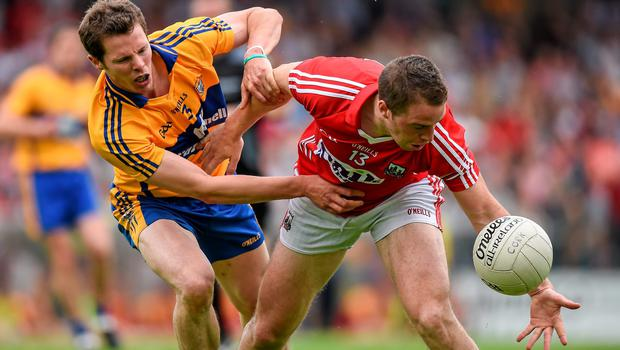 Brian Hurley, Cork, in action against Ciaran Russell, Clare