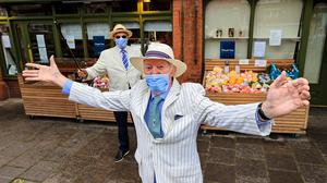 Tom Fitzgerald and Peter Caviston enjoy Bloomsday 2020 while social distancing in Glasthule village. Picture; Gerry Mooney