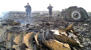 Emergency workers at the Malaysia MH17 crash site