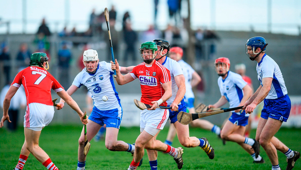 Seamus Harnedy of Cork in action against Shane Bennett and Kevin Moran of Waterford
