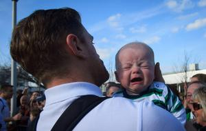 22/03/2015 Jamie Heaslip with Irish fan Charlie Hassett 3 months from Tipperary after the Irish Rugby side  arrived  at Dublin Airport following their 6 Nations Championship win  Photo:  Gareth Chaney Collins