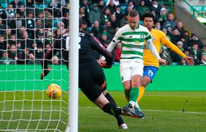 Leigh Griffiths scores Celtic's third goal against Kilmarnock. Photo: Andrew Milligan/PA Wire