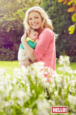 Model and fitness fanatic Nell McAndrew 39, with her new baby daughter Anya,  appearing in this week's Hello! Magazine.