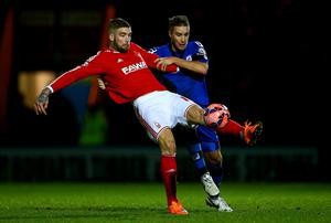 Lars Veldwijk of Nottingham Forest battles for the ball with Oliver Lancashire of Rochdale