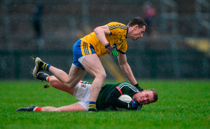 Danny Kirby of Mayo in action against Niall McInerney of Roscommon. Photo: Piaras Ó Mídheach/Sportsfile