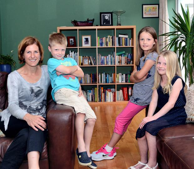 Working mum: Suzanne with her children Hannah, Eleanor and James