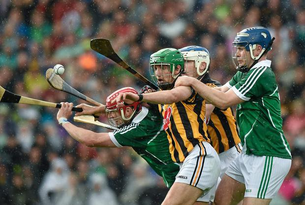 Limericks' Seamus Hickey and Richie McCarthy keep close tabs on Kilkenny's Mark kelly and TJ Reid last weekend. Our guess