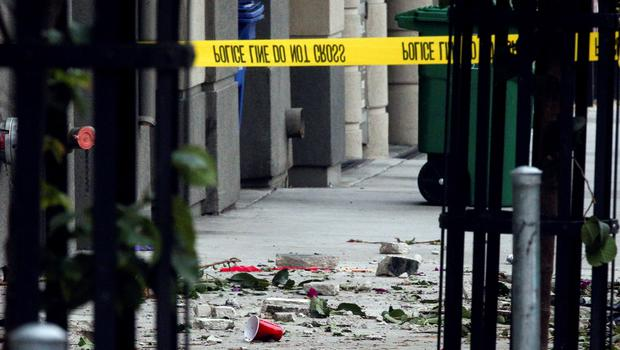Debris is seen on the sidewalk below a 4th-story apartment building balcony collapse in Berkeley, California June 16, 2015. Five young Irish citizens were killed and at least eight other people were injured when an apartment balcony collapsed early on Tuesday in the Californian city of Berkeley, Ireland's foreign minister said.  REUTERS/Elijah Nouvelage