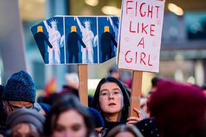 People protest in solidarity with the Women's March in Washington at the same time as the U.S. Presidential inauguration, in Brussels on Friday, Jan. 20, 2017. (AP Photo/Geert Vanden Wijngaert)