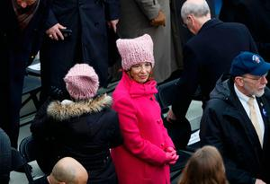 "U.S. Rep. Jackie"" Speier (C) and another woman wear their pink protest hats, symbols of the anti-Trump women's march, as people gather prior to U.S. President-elect Donald Trump's inauguration as the nation's 45th president in Washington, U.S., January 20, 2017.    REUTERS/Brian Snyder"