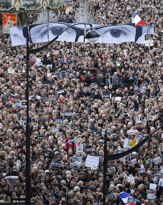 The crowd gather during the march in Paris, France, Sunday, Jan. 11, 2015. Hundreds of thousands of people marched through Paris on Sunday in a massive show of unity and defiance in the face of terrorism that killed 17 people in France's bleakest moment in half a century. (AP Photo/Laurent Cipriani)