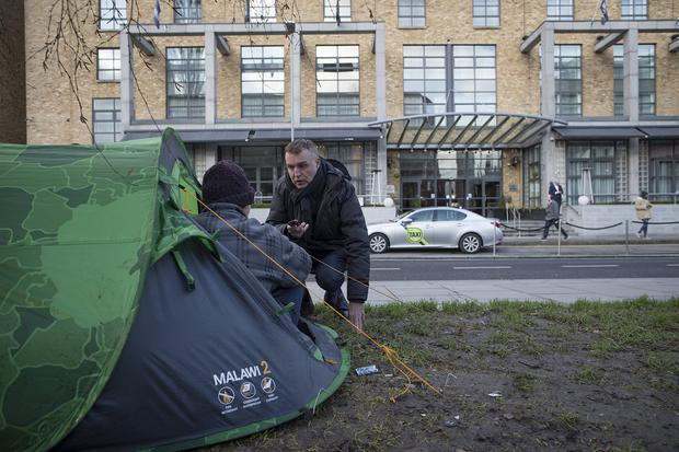 A homeless man with his tent across from the Hilton Hotel in Dublin. Picture: Arthur Carron