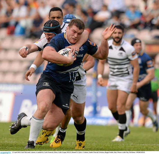 Jack McGrath, Leinster, is tackled by Carlo Festuccia, Zebre in a Celtic League game