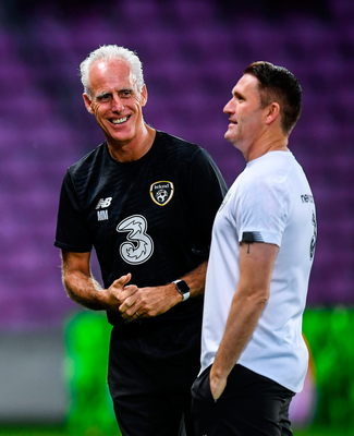 Mick McCarthy is pictured with his assistant Robbie Keane at Stade de Genève in Switzerland last October. Photo: Sportsfile