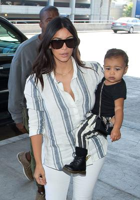 Kim Kardashian, Kanye West, and North West seen at LAX on September 01, 2014 in Los Angeles, California.  (Photo by GVK/Bauer-Griffin/GC Images)