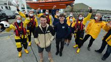 Local fisherman Patrick Oliver with his son Morgan, who rescued the two ladies in the sea pictured with members of Galway Lifeboat  Photo: Ray Ryan