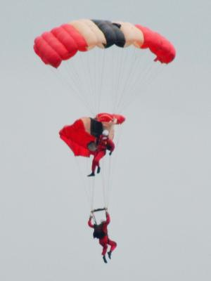 The 'Red Devils' who were performing at the Whitehaven Air Show on the Cumbrian coast last night, when a team members chute failed to open - leaving a team-mate to catch him in mid-air and bring him to safety (Stephen Miller/PA Wire)