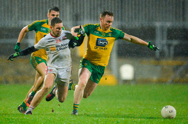 Eamon Doherty of Donegal in action against Niall Sludden of Tyrone. Photo by Oliver McVeigh/Sportsfile