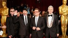 Larry Mullen Jr, The Edge, Bono and Adam Clayton (L-R) of the band U2 pose for photographers at the 86th Academy Awards