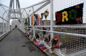 GV of flowers and memorials for Dale Creighton, assaulted on footbridge over Tallaght bypass on January 1st. Footbridge from St Domicic's road over Tallaght bypass, Tallaght, Dublin.