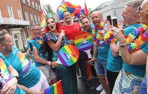 PARADE: Drag queen Avril Nitrate with Taoiseach Leo Varadkar on the Aer Lingus float at last year's Pride. Photo: Julien Behal