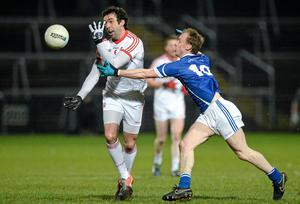Joe McMahon offloads the ball before being tackled by Cavan's Martin Reilly