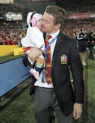 Brian O'Driscoll with his daughter Sadie on the pitch after the Lions victory at the ANZ Stadium, Sydney, Australia