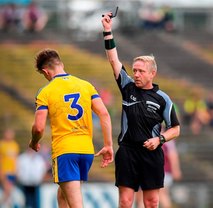 Roscommon's Sean Mullooly receives a black card from referee Ciaran Branagan in last Sunday's Connacht SFC final replay. Photo by Stephen McCarthy/Sportsfile