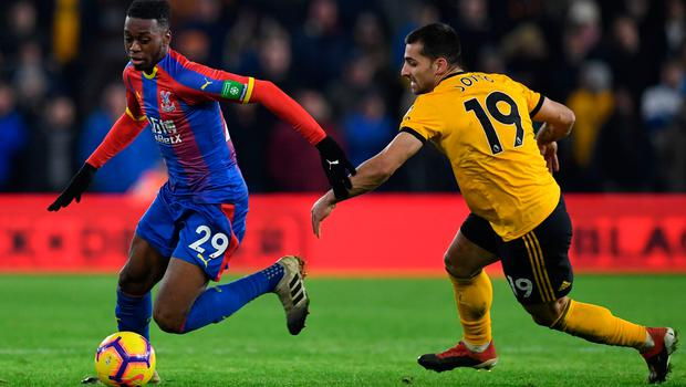Crystal Palace's Aaron Wan-Bissaka keeps possession ahead of Wolves' Jonny Otto. Photo: Getty Images