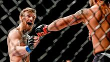 Conor McGregor taunts Chad Mendes during their Interim UFC Featherweight Championship Title bout at UFC 189. MGM Grand Garden Arena, Las Vegas, USA. Picture credit: Esther Lin / SPORTSFILE