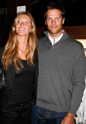 Model Gisele Bundchen (L) and New England Patriots quarterback Tom Brady attend the opening of Ermenegildo Zegna Global Store on 5th Avenue on March 11, 2008 in New York City.  (Photo by Amy Sussman/Getty Images)