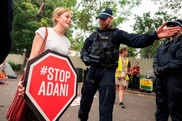 Protest: Police disperse people during a climate protest outside Australian Prime Minister Scott Morrison's official residence in Sydney. Photo: WENDELL TEODORO/AFP via Getty Images