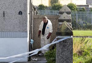 Serious damage: A garda at the scene of an arson attack on the home of an innocent family in Laurence's Park, Drogheda. PHOTO: COLIN KEEGAN/COLLINS
