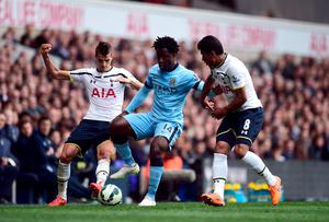 Manchester City's Wilfried Bony battles for the ball with Tottenham Hotspur's Paulinho (right) and Erik Lamela (left) during the Barclays Premier League match at White Hart Lane, London earlier this month (Adam Davy/PA Wire)