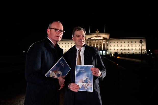 Irish Foreign Affairs minister Simon Coveney (left) and Secretary of State for Northern Ireland Julian Smith, issue a statement outside Stormont Parliament buildings in Belfast, where meetings with parties involved in talks to resurrect the devolved government in Northern Ireland have been taking place. Photo: Niall Carson/PA Wire