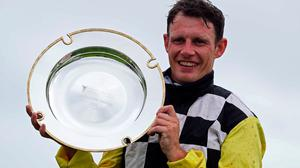Paul Townend celebrates with the trophy after winning the Guinness Handicap Hurdle onboard Great White Shark during day five of the 2020 Galway Races Summer Festival. Photo credit: Brian Lawless/PA Wire