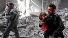 Children are evacuated from the rubble of destroyed buildings following reported government airstrikes on the outskirts of Damascus Photo: SAMEER AL-DOUMY/AFP/Getty Images
