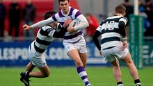 James Lappin, Clongowes Wood College, is tackled by Declan Monaghan, Belvedere College