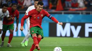 Portugal's Cristiano Ronaldo scores his side's second goal from the penalty spot during the Euro 2020 Group F draw with France at the Puskas Arena in Budapest on Wednesday