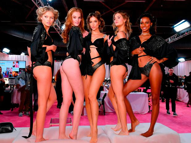 (L-R) Maggie Laine, Alexina Graham, Myrthe Bolt, Barbara Palvin, and Leomie Anderson prepare backstage during 2018 Victoria's Secret Fashion Show in New York at Pier 94 on November 8, 2018 in New York City.  (Photo by Dia Dipasupil/Getty Images for Victoria's Secret)