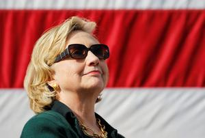 Hillary Clinton listens to speeches at the 37th Harkin Steak Fry in Indianola, Iowa, where she told crowds she was 'thinking about' running for the US presidency in 2016. Photo: REUTERS/Jim Young