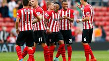 Southampton's Ryan Bertrand  celebrates their victory over QPR with his team-mates. Julian Finney/Getty Images