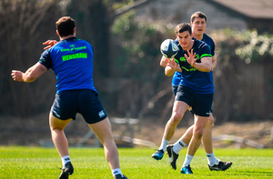 Jonathan Sexton of Leinster takes a pass from team-mate Robbie Henshaw during a Leinster rugby squad training session