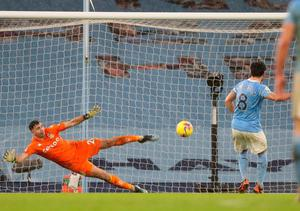Manchester City's Ilkay Gundogan slots his side's second goal past Aston Villa's Emi Martinez from the penalty spot. Photo: Getty Images