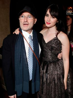 DAUGHTER DEAREST: Phil and Lily Collins in what we presume were happier times Picture: Getty