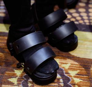 A woman wears Taclim VR shoes at the Cerevo booth during CES Unveiled before CES International, Tuesday, Jan. 3, 2017, in Las Vegas. The shoes have haptic feedback. (AP Photo/John Locher)