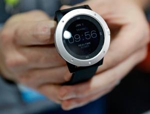 An employee demonstrates the Matrix Powerwatch during CES Unveiled before CES International, Tuesday, Jan. 3, 2017, in Las Vegas. The smart watch is powered by body heat from the wearer. (AP Photo/John Locher)