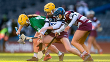 Siobhán McGrath of Sarsfields in action against Gráinne Ní Chatháin and Clare McGrath of Slaughtneil. Photo by Harry Murphy/Sportsfile