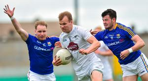Kildare's Peter Kelly of Kildare in action against Longford's Gary Rogers (right) and Barry McKeon during the Leinster SFC quarter-final replay at Bord na Mona O'Connor Park in Tulamore, Offaly. Photo: Matt Browne/Sportsfile